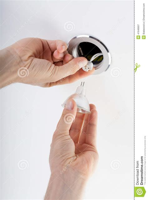 putting lights on a timer putting in a bulb stock photo image 41646607
