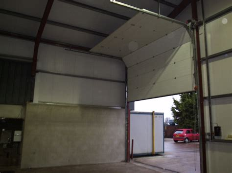 sectional overhead door sectional overhead door adgey awnings shutters