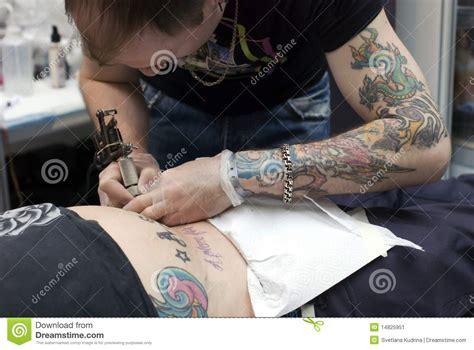 tattoo artist at work at saint petersburg tattoo f