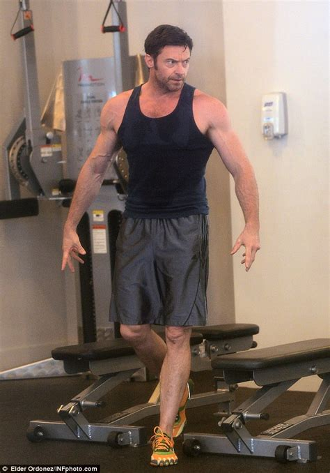 hugh jackman flexes his mean biceps and rock hard abs