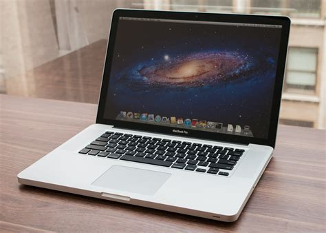 mac picture book macbook pro survives the cut for now cnet