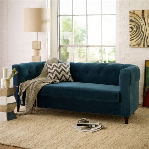 paint colors for living room with blue furniture a blue sofa in a white living room decoist