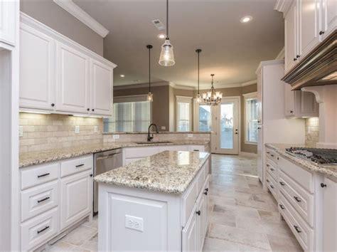 white kitchen flooring ideas spacious white kitchen with light travertine backsplash and rectangular 12 quot x24 quot floor tiles
