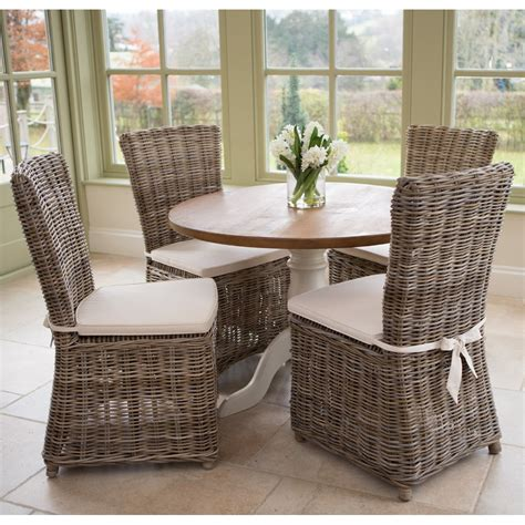 Obsidian Kitchen Knives dining table and wicker chairs brown ravenna rattan