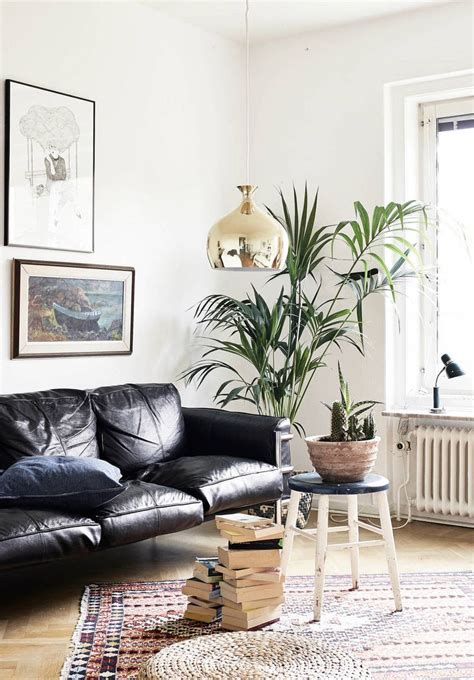 living room with black leather sofa how to decorate a living room with a black leather sofa
