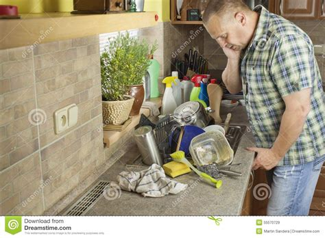 All Metal Kitchen Faucet man washing dirty dishes in the kitchen sink stock photo