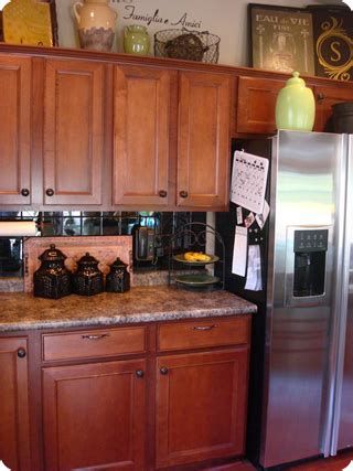 decorating ideas for kitchen cabinet tops decorating ideas for the top of kitchen cabinets pictures afreakatheart