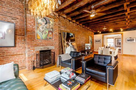 A 32 Foot Long Living Room with Exposed Brick Dominates