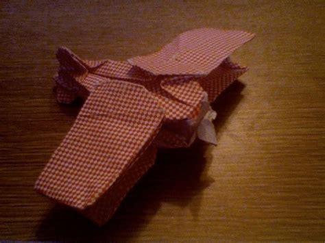 origami biplane biplane by robert lang scrapbook paper wetfolded in 2007