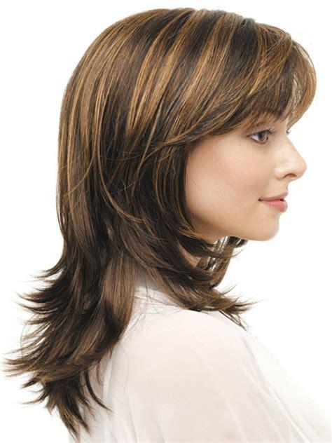 layered medium lenght hair with bangs 16 striking layered hairstyles for medium length hair