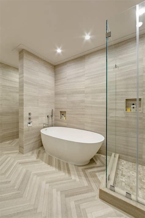 modern master bathroom high ceiling herringbone tile floors by artistic tile on