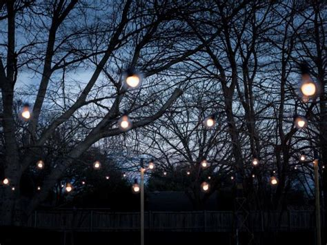 poles to hang string lights how to hang outdoor string lights from diy posts hgtv