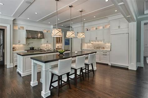 white kitchen islands side by side white kitchen islands with honed black marble
