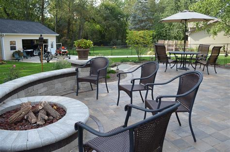 a paver patio 4 reasons to replace your wooden deck with a paver patio