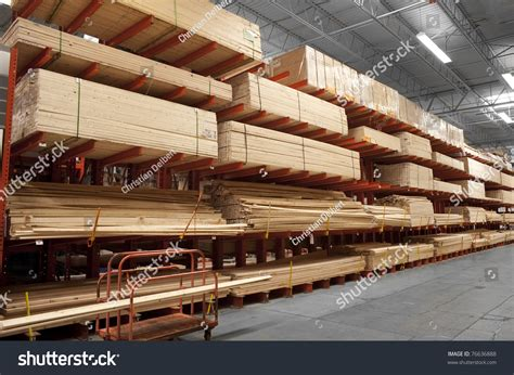 woodworking warehouse wood stacked on shelving inside a lumber yard stock photo