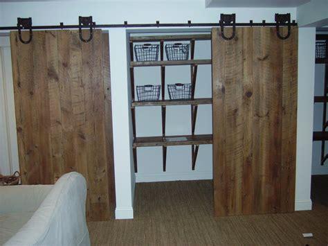 barn door style closet doors custom barn door closet by reclaimed wood furnishings