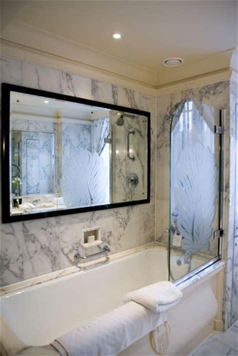 tv in mirror bathroom bathroom mirror tv above marble bathtub