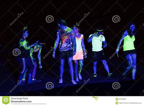 glow in the paint south africa fluorescent light splashed revelers of the glow run port