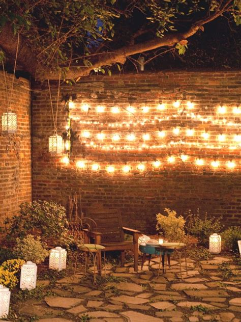 wall string lights outdoor wall decor ideas with wood plants and lights