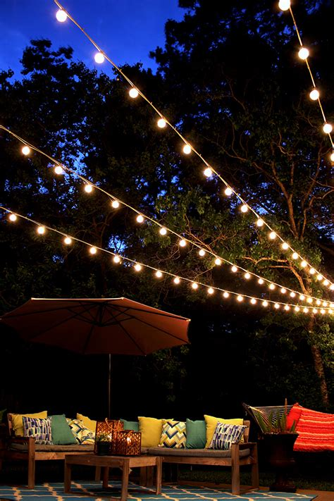 backyard lights string a canopy of string lights in our backyard gray house studio