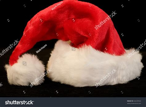 santa hat black bright and santa hat on black background stock photo