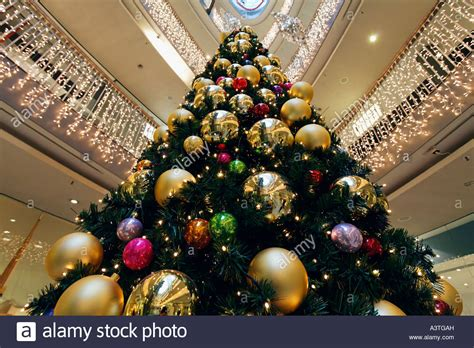 tree with big ornaments tree decorated with big balls at the of a