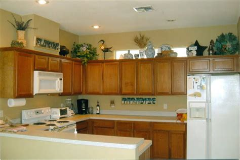 decorating ideas for kitchen cabinet tops the tricks you need to for decorating above cabinets laurel home