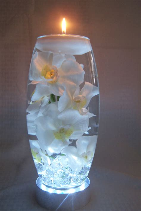 water in vases white orchids in water all in a 12 inch vase which sits on a