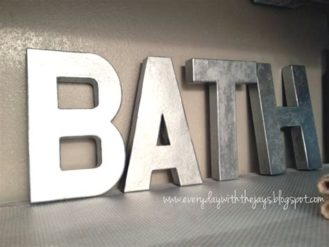 spray paint cardboard hobby lobby cardboard letters painted with metallic spray