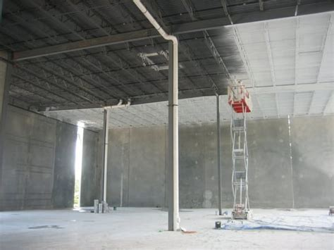 spray painting walls and ceilings interior warehouse ceiling decking spray painting of