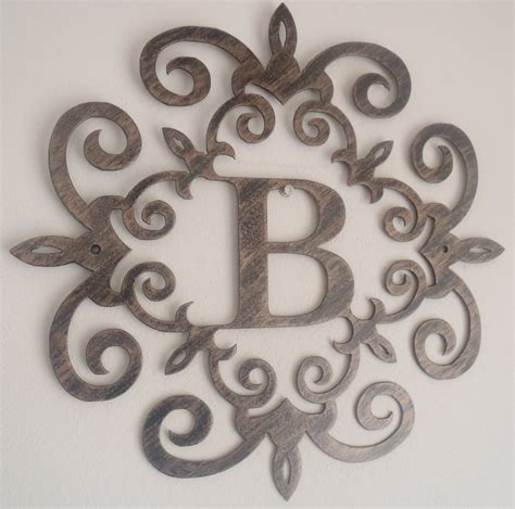family initial monogram inside a metal scroll with b letter 12 inches wall decor metal