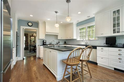 white and blue kitchen cabinets white cabinets blue gray walls black counter white
