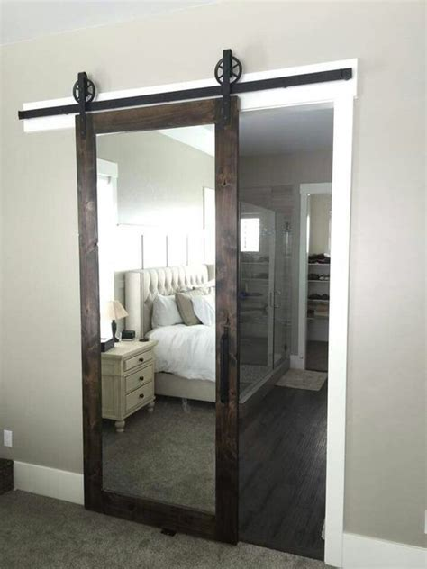 this mirrored barn door for a master bedroom