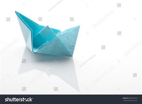 origami paper white origami paper ship on white background stock photo