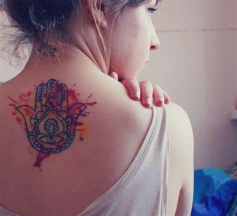 this spiritual hamsa hand tattoos has creative watercolor