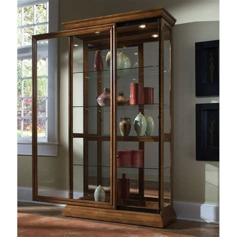 pulaski 2 way sliding door curio cabinet in golden oak 20544
