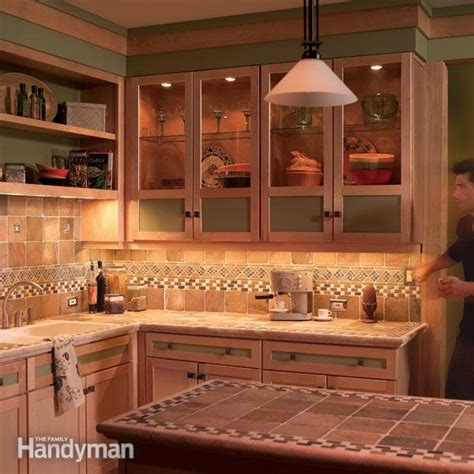 adding cabinet lighting how to install cabinet lighting in your kitchen