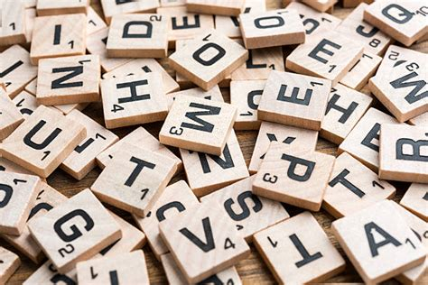 scrabble words with q and w scrabble tiles pictures images and stock photos istock