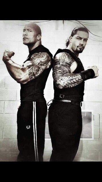 the rock and his cousin roman reigns they are also