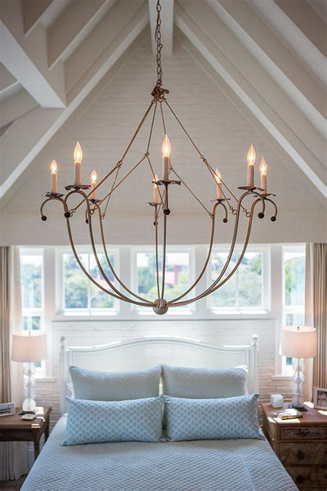 bedroom with chandelier house with airy coastal interiors home bunch