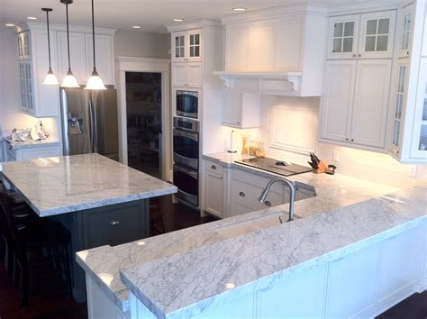 carrara marble kitchen island the granite gurus carrara marble kitchen from mgs by design