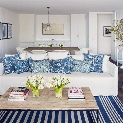 white slipcovered sofa white slipcovered sofa with blue pillows cottage