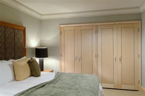 closet doors ideas for bedrooms closet door ideas bedroom eclectic with bare bulb pendant