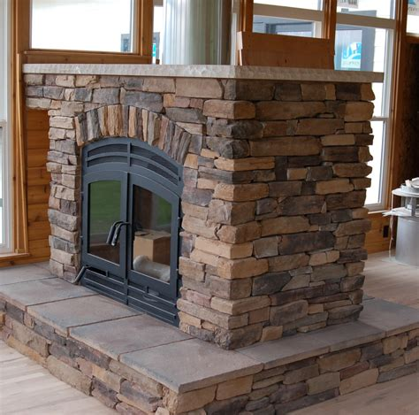 Traditional See Thru Wood Sided Fireplace With