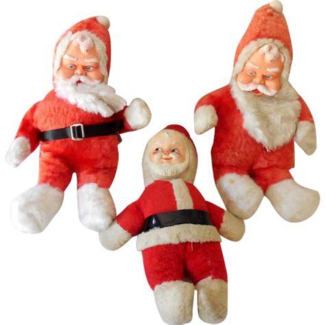 santa rubber st 3 vintage rubber plush santa claus dolls from