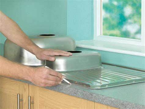 how to fit kitchen sink how to install a kitchen sink in a laminate or wood