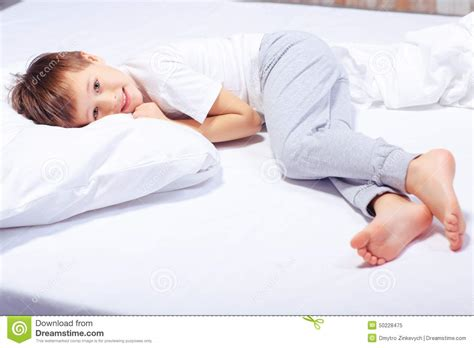 in a bed portrait of a boy in bed with pajama stock image image