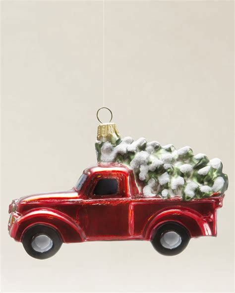 tree with ornaments bringing home a tree up truck with