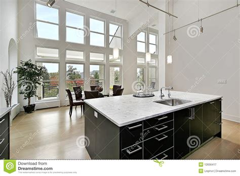 home design story room size modern kitchen with two story windows stock image image