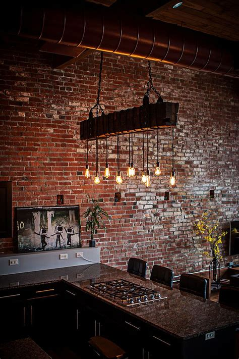 industrial loft kitchen with light dashing loft uses contrasting textures to create